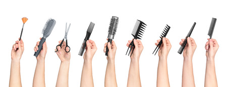 collection of hands holding tools for hair salon isolated on white background