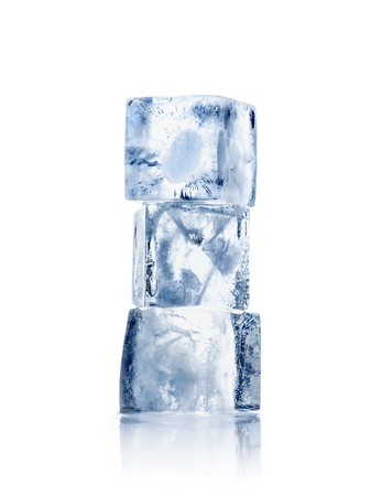 Three ice cubes on a white background with reflection