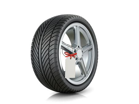 sell out: Automotive wheel with a tag on a white background.