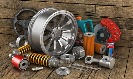 Set of auto parts on the old wood background.
