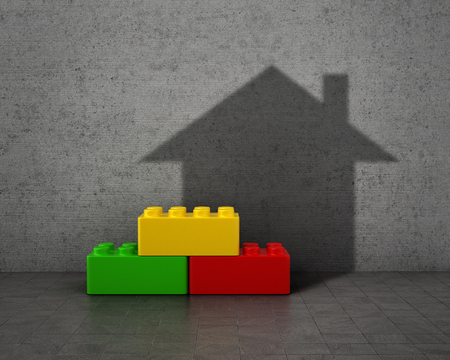 concrete form: Concept of house. Colorful building blocks with shadow in form of house on concrete wall.