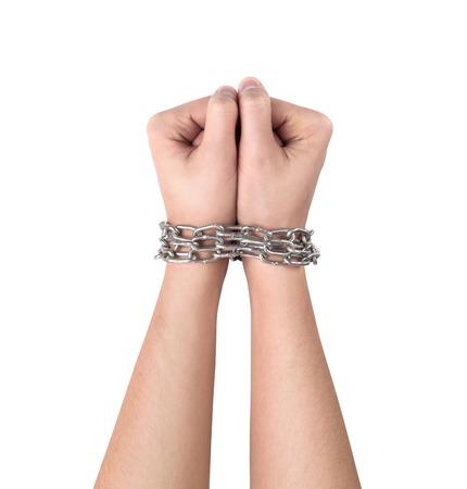 delincuencia: Manos con la cadena enrollada alrededor de ellos