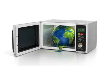 warming: Global warming concept - earth in microwave. Stock Photo