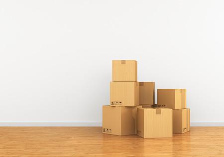 Caja de cartón en un apartamento vacío. El concepto de pasar a un nuevo con gelatina Foto de archivo - 54742722