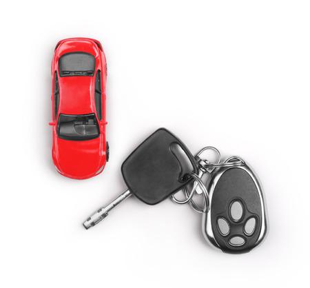 Speel goed auto en sleutels geïsoleerd op witte achtergrond