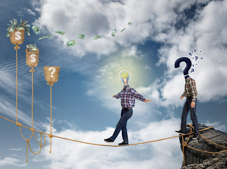 risky business: Young businessman walking on the rope to financial success, against the sky. The concept businessmen undertake risky business in crisis. Stock Photo