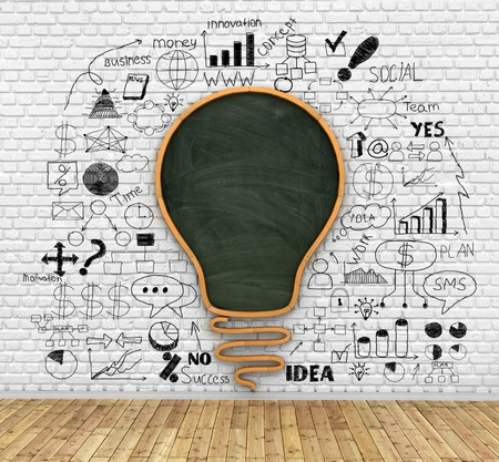 knowlage: school blackboard in shape of idea lightbulb on the breaks wall, idea and knowlage concept Stock Photo
