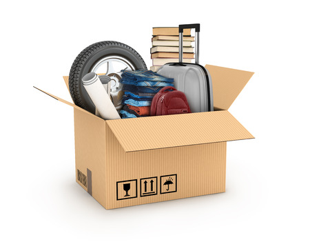 relocation: cardboard boxe with books, bag, weel and clothes, relocation moving concept Stock Photo
