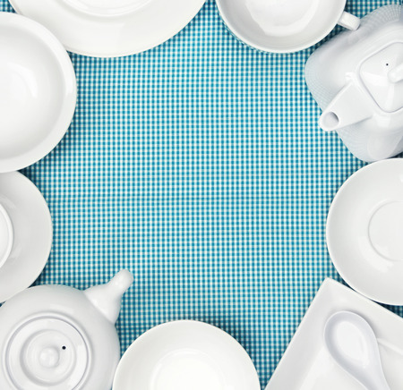 checkered tablecloth: white dishes on blue checkered tablecloth