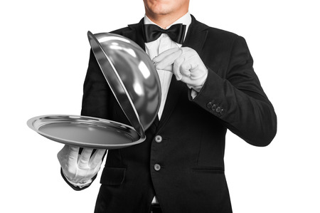 food tray: waiter holds tray with metal lid isolated on white background Stock Photo