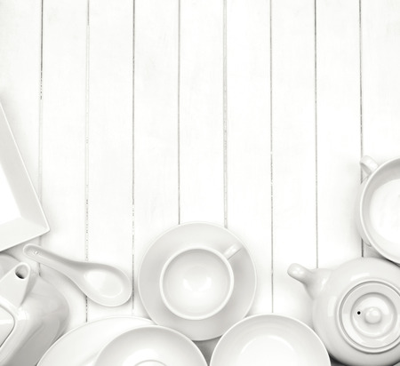 grunge flatware: white dishes on a white wooden background