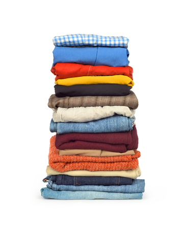 over packed: family laundry pile of clothing isolated Stock Photo
