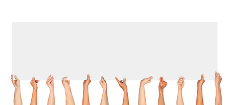 rally finger: Many hands holding a blank poster for advertising on an isolated white background Stock Photo