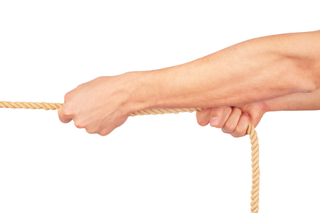 Hands pull a rope. Isolated white background Stock Photo