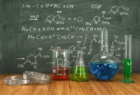 acids: Test-tubes with various acids and other chemicals on the background of the blackboard, organic chemistry concept
