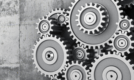 concrete background: Mechanism of gears on a concrete background. 3d illustration Stock Photo