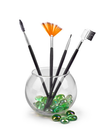 grooming product: Make-up Brushes in a glass flask on white Stock Photo