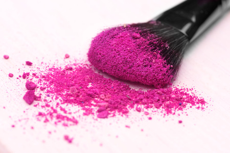 make-up brush on pink crushed eyeshadow Stock Photo