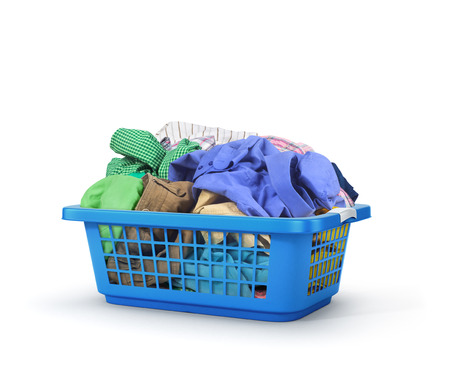 Colorful clothes in a laundry basket isolated on white background. Reklamní fotografie