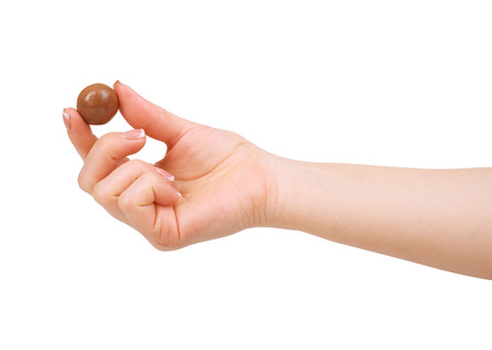 foretaste: candy chocolate in hand on white
