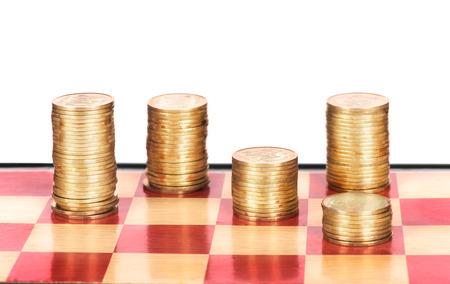 tablero de ajedrez: Coins on chessboard Foto de archivo
