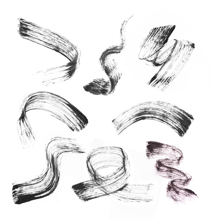 Collection of stroke (sample) of black mascara, isolated on white