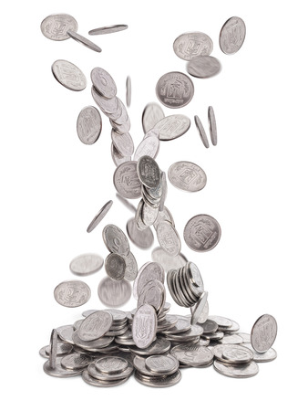 Heap of silver coins falling to the ground