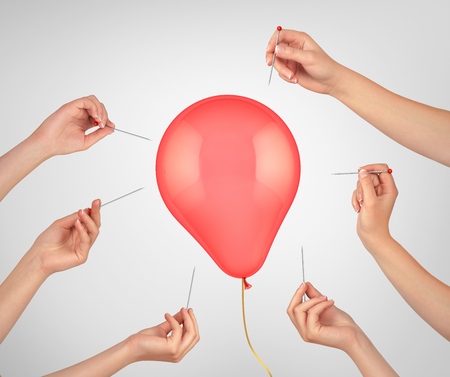 money sphere: Concept of finance risk.  Many hands hold the needles directed to air balloon. 3d illustration