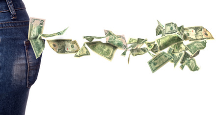falling out: dollar bills falling out of pocket isolated on white