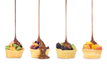 blanketed: Chocolate pouring on fruit in waffle cup Stock Photo