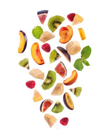 Fresh mixed fruits pieces falling, fruit salad isolated on white