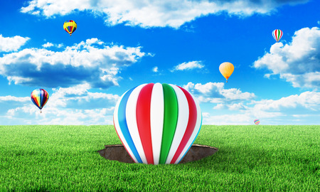 intention: Up. Concept of intention. The balloon takes off from a hole in the ground under the blue sky. Beauty wallpaper. Stock Photo