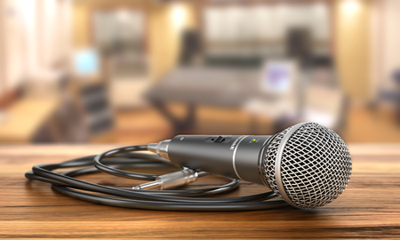 Microphone with cable on a studio background. 3d illustration
