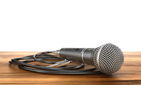 accreditation: Microphone with cable on a wood background. 3d illustration