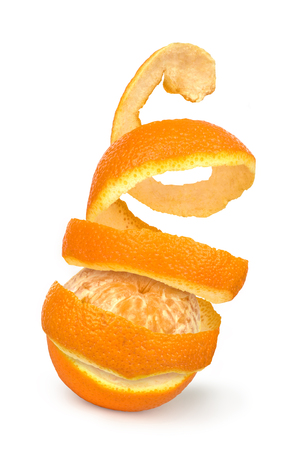 orange peel skin: Orange posed on a orange peel against white background