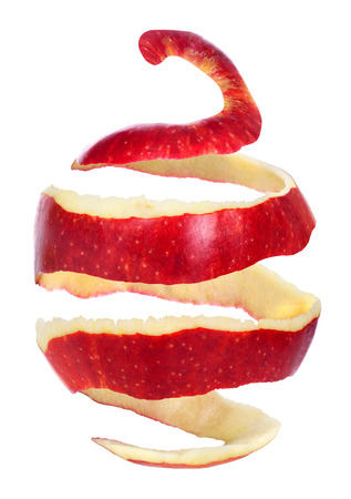 apple with peeled skin on white background