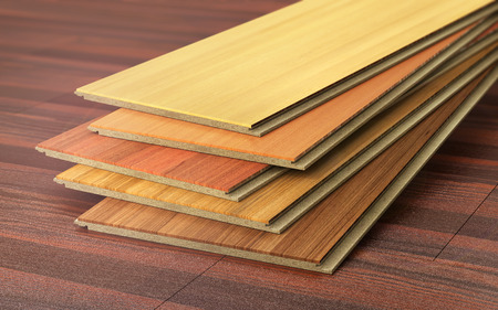 flooring: Stack of wooden laminate parquet on a wooden blur background. 3d illustration