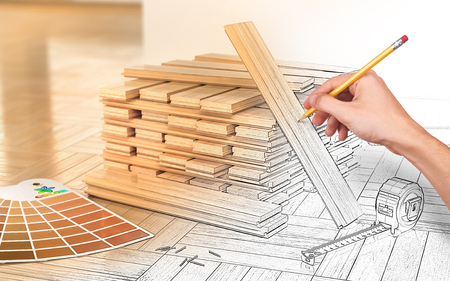 Design concept. Stack of parquet on a floor. Human hand drawing the part of image. 3d illustration