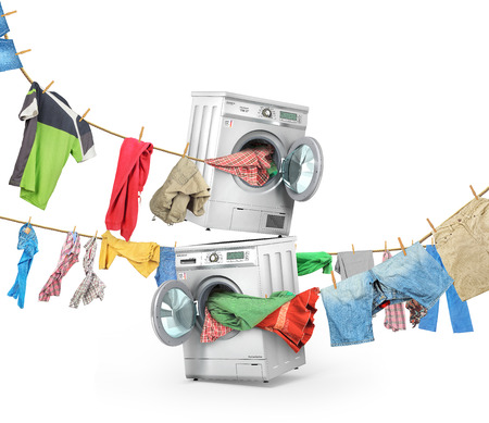 The big washing concept. Clothing on the ropes rushes from the washing machine and dryer isolated on a white background