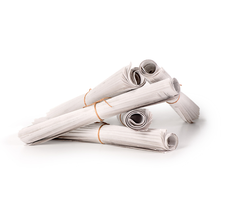 A pile of folded newspapers