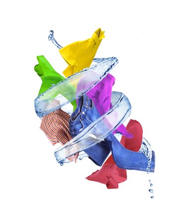 Splash of water in the form of a spiral with clothes on a white background. Stock Photo