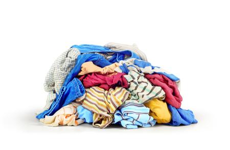 washhouse: Pile of clothes isolated on white background Stock Photo