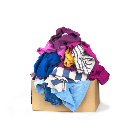Box with clothes on white background.