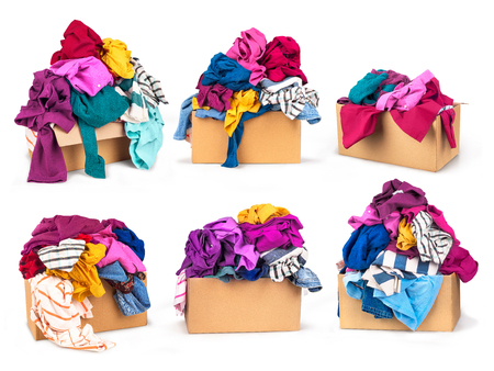 Set of boxes with clothes on white background. Stock Photo