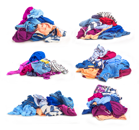 Set of heaps of clothes. On a white background there are several large piles of outlined clothes. Stock Photo