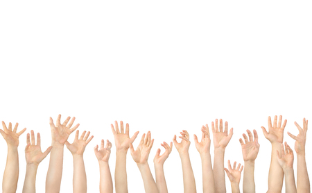 Many hands raised up in the air on white background