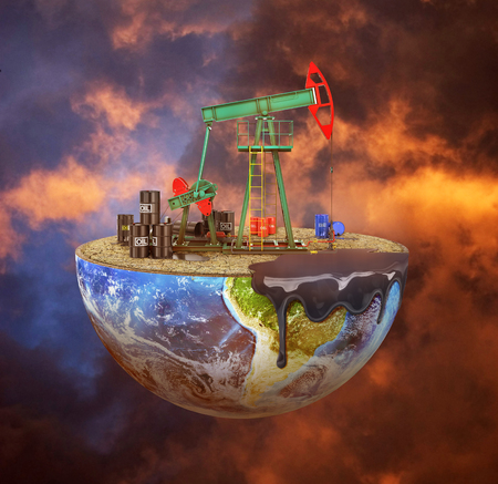 Eco-concept. Oil pump on a cut planet on moody background. The concept of natural resource extraction. Save the planet.