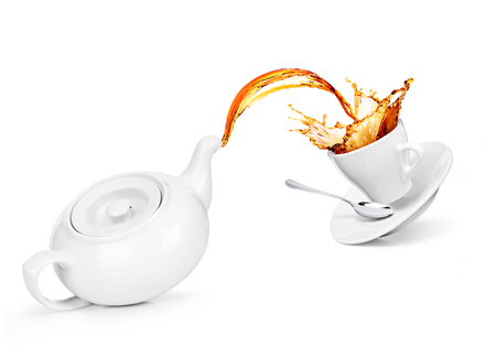 Concept kettle with a cup. Tea is poured into a cup, isolated on a white background Stock Photo