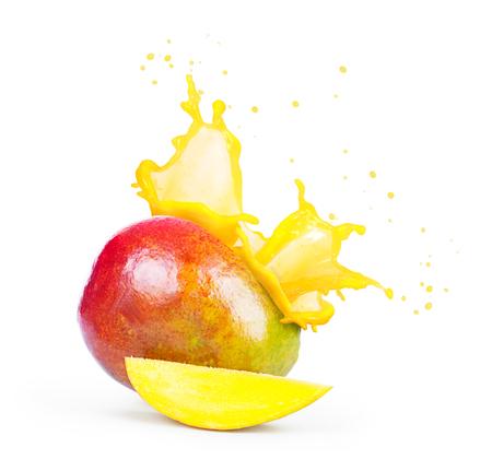 Mango with a splash of mango juice isolated on white background