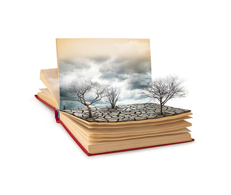 Open book with a gloomy landscape isolated on white background